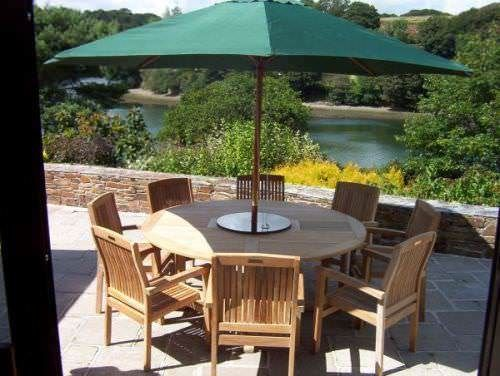 1.8m Teak Circular Fixed Table with Granite Lazy Susan and 8 Marley Armchairs