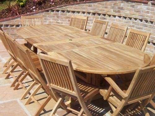 1.2m x 2.2m - 3.2m Teak Oval Double Extending Table with 10 Kiffa Folding Chairs and 2 Armchairs